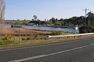 Nicholson, Victoria - Eastern entry to town looking across the Nicholson River to the boat ramp