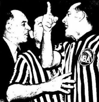Norm Drucker - Norm Drucker ejecting Boston Celtic Coach Red Auerbach from a 1960 game at Madison Square Garden. Referee Arnie Heft attempts to keep the two separated.