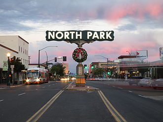 North Park, San Diego - North Park sign near the intersection of 30th Street and University Avenue at dusk.