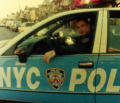 Officer Anthony Mosomillo in NYPD Chevrolet Caprice.png