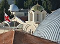 Old Jerusalem Greek Orthodox Patriarchate golden dome and flag.jpg