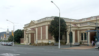 Toitū Otago Settlers Museum - Toitū Otago Settlers Museum main wing (Dunedin Railway Station is visible in the background)