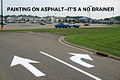 Painting on Asphalt--No Brainer, Walmart Entrance, Ravenna, Ohio, USA.jpg