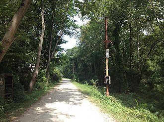 Pennypack Trail - Pennypack Trail north of Lorimer Park, with a former railroad signal pole visible