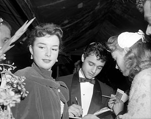 Sal Mineo - Gigi Perreau with Mineo signing autographs at the premiere of The Man in the Gray Flannel Suit (1956)