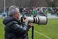 Photographer with telephoto lens on football game.jpg