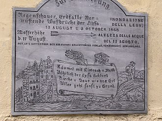 Gressoney-Saint-Jean - Memorial plaque of the 1868 flood written in German and Italian. The plaque shows the high water mark which the river Lys reached on August 17.