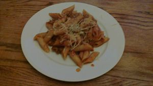 Plated penne pasta with hearty meat sauce.jpg