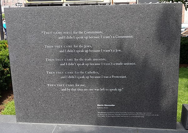 "Martin Niemoeller's poem ""First they came..."" inscribed on a stone in the New England Holocaust Memorial."