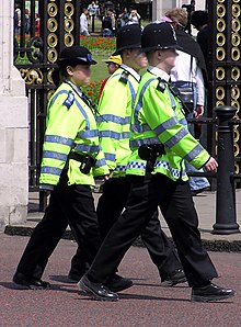 d890247e49 2 Metropolitan Police officers (males) and a PCSO (female) wearing  hi-visibility jackets
