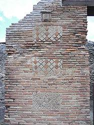 Pompeii phallus relief.jpg