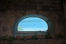 A Photo Of The Underground Pool Window That Features In Apartment Block