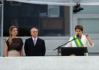 Michel Temer - President Dilma Rousseff delivers her inaugural address as Vice President Temer and wife Marcela look on, 1 January 2011.