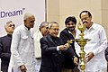 Pranab Mukherjee lighting the lamp to inaugurate the two day International Seminar on 'Clean and Capable India of Gandhiji's Dreams', in New Delhi on March 12 2015. The Union Minister for Urban Development.jpg