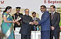 Pranab Mukherjee presenting the National Award for Teachers-2013 to Shri Govada Ajai Babu, Aandhra Pradesh, on the occasion of the 'Teachers Day', in New Delhi. The Union Minister for Human Resource Development.jpg