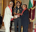 Pranab Mukherjee presenting the Silver Elephant Award 2011-2012 to the Governor of Jammu & Kashmir, Shri N.N. Vohra, at the presentation of the Rashtrapati Scouts & Guides Awards for the year-2011 & 2012.jpg