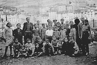 War Resisters' International - Refugees from the Spanish Civil War at the War Resisters' International children's refuge at Prats-de-Mollo in the French Pyrenees, some time between 1937 and 1939. The warden of the home, Professor José Brocca is standing third from left in the photograph.