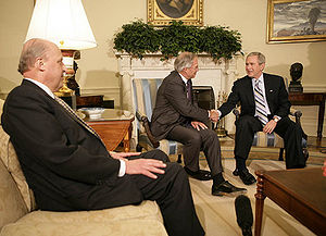 Porter Goss - President George W. Bush and Director of National Intelligence John Negroponte (left) accept Goss's resignation in the Oval Office on May 5, 2006.