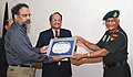 Prof. Rajashekaran Pillai and Dr. K. Ravi Kant, Director IGNOU, presenting a memento to the Chief of Army Staff, Gen. V.K. Singh, in New Delhi on August 20, 2010.jpg