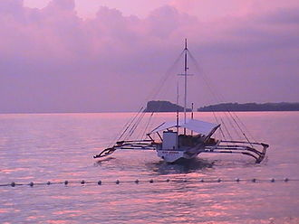 Transportation in the Philippines - A pump boat at sunset off of Guimaras.
