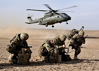 No. II Squadron RAF Regiment - Members of II Squadron, RAF Regiment with an RAF Merlin helicopter landing during operations in Afghanistan, 2012
