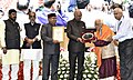 """Ram Nath Kovind presenting the """"Vayoshreshtha Sammans - 2017"""" to eminent senior citizens and institutions in recognition of their service towards the cause of the elderly persons, at a function, in New Delhi (5).jpg"""