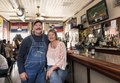 Ray Vertovec, a longtime livestock farmer turned tavern owner, and his wife, Cheryl, enjoy the ambience at the bar at Eiler's Place, a popular watering hole in the Pueblo, Colorado LCCN2015632690.tif