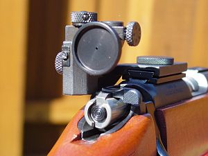 Accurizing - A target aperture sight, mounted on the receiver. This rearward mounting position provides a long sight radius, and the small aperture provides a long depth of field and precise alignment