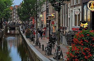De Wallen, Amsterdam's Red-light district, offers activities such as legal prostitution and a number of coffee shops that sell cannabis. It is one of the main tourist attractions. Red-light district of Amsterdam by day. 2012.JPG