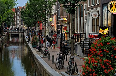 De Wallen, Amsterdam's Red-light district, offers activities such as legal prostitution and a number of coffee shops that sell marijuana, symbolising the Dutch political culture and tradition of tolerance. Red-light district of Amsterdam by day. 2012.JPG