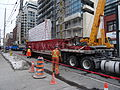 Removing the big boom crane from atop the almost finished reconstruction of the old National Hotel, 2015 03 07 (3) (16758772572).jpg