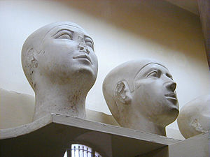 Reserve head - Two reserve heads displayed side-by-side on a shelf display at the Egyptian Museum, Cairo.