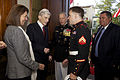 Retired U.S. Sen. John Warner, second from left, a former secretary of the Navy and the Evening Parade guest of honor, greets a U.S. Marine Corps sergeant, center right, as Warner's wife, Jeanne Vander Myde 130503-M-LU710-028.jpg