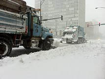 Retrofitted Garbage trucks with snowplows shoveling snow on Clark and Fullerton Chicago storm feb 2 2011.JPG