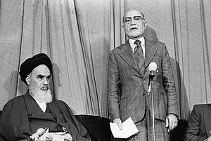 Mehdi Bazargan - Bazargan sworn in as prime minister behind Ruhollah Khomeini in the absence of Parliament