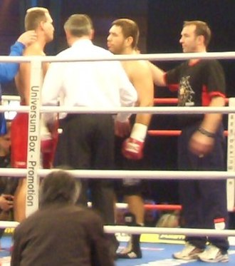 Ruslan Chagaev - Ruslan Chagaev (center) inside the ring with his coach Michael Timm (right) challenging Rob Calloway (left). 7 January 2006).