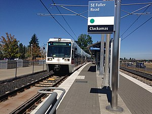 SE Fuller Road MAX station with SB train.jpg