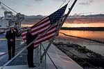 Sailors raise the ensign during morning colors aboard USS John C. Stennis. (30736120056).jpg