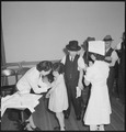 San Francisco, California. As a safeguard for health, evacuees of Japanese descent were inoculated . . . - NARA - 536395.tif