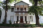 The double-storeyed house, Saxenhof, was formerly also known as Neethling House. The land on which this house stands was granted to Pieter Andriesz Saxe already in 1704. He owned the place for sixteen years and it is accepted that it was he who built the original H-shaped Cape Dutch house. In 1889 the house was sold to Dr. Johannes Henoch Neethling, who shortly after converted the old single-storeyed house into a charming Georgian type double-storeyed house. The original and beautiful old ceilings as well as a few side and back windows of the old house were kept intact.