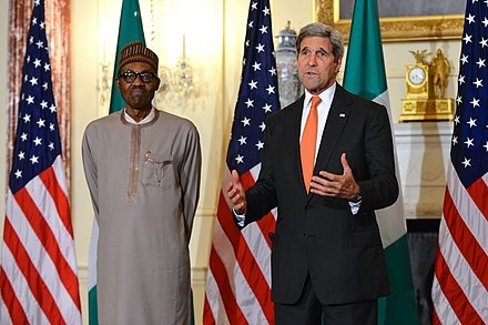 Muhammadu Buhari giving talk before Working Lunch with Secretary Kerry Secretary Kerry and Nigerian President Buhari Address Reporters Before Their Working Lunch (19706078818).jpg