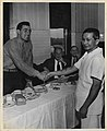 Sgt. John Basilone with a cook (4455267374).jpg