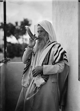 Biblical Sabbath - Yemenite Jew blowing the shofar (ram's-horn trumpet) for Sabbath in the 1930s.