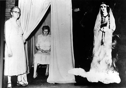 The spirit guide Silver Belle was made from cardboard. Both Ethel Post-Parrish and the lady standing outside of the curtain were in on the hoax. Silver Belle Fraud.jpg