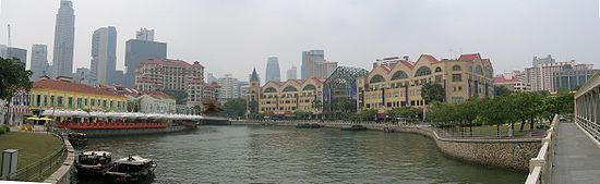 Panoramic view of the Singapore River. There are numerous bars, pubs, seafood restaurants and tall commercial buildings along the river.