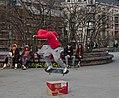 Skateboarder jumping over a cardboard box at Skatepark des Ursulines in Brussels, Belgium (DSCF4497).jpg