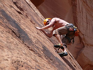 Slab climbing - A climber smearing on the rock, near Moab, Utah.