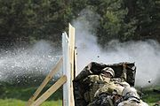 Slovenian Army Special Operations Soldiers and Soldiers of 5th Battalion, 19th Special Forces Group, Colorado Army National Guard, practice explosive breaching techniques