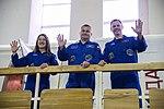 Soyuz MS-12 crew members wave to reporters in Star City, Russia.jpg