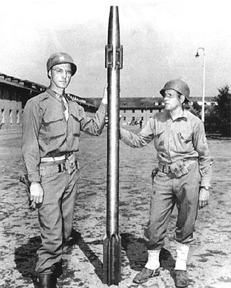 Fortress of Mimoyecques - Two US Army soldiers with a captured Sprenggranate 4481 projectile, which would have been fired from the V-3 at a rate of  1 every 6 seconds.